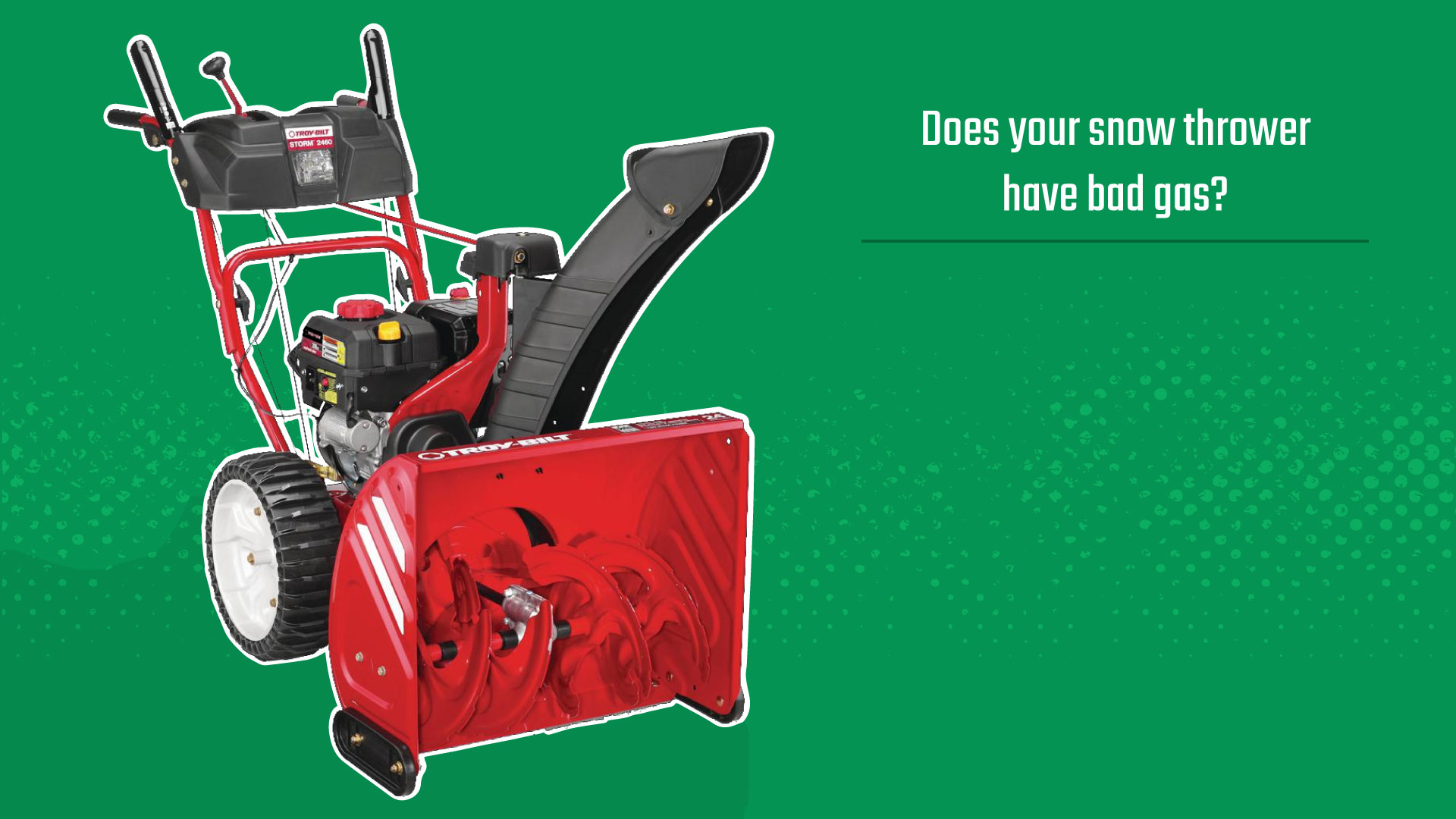 red troy bilt snow thrower on green background